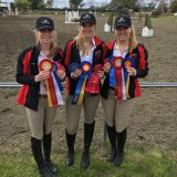 girls smiling with awards