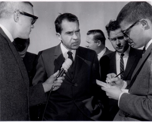 Trustee David Henley covered several U.S. presidents during his journalism career. A note-taking Henley is pictured here with President Richard Nixon.