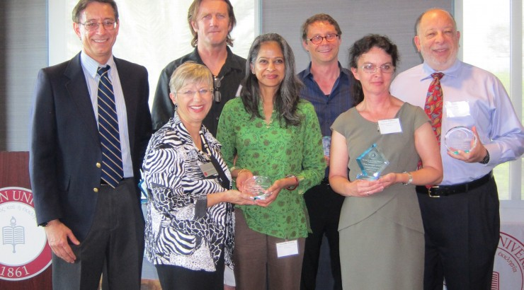 Recipients of awards presented at the Faculty Research Recognition Reception included, back row, from left, Laurence Iannaccone, Warren de Bruyn, Bart Wilson and Fred Caporaso; front row, from left, Judith Montgomery, Anuradha Prakash and Tatiana Prytkova.