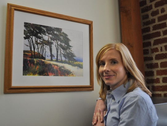 woman smiling with artwork