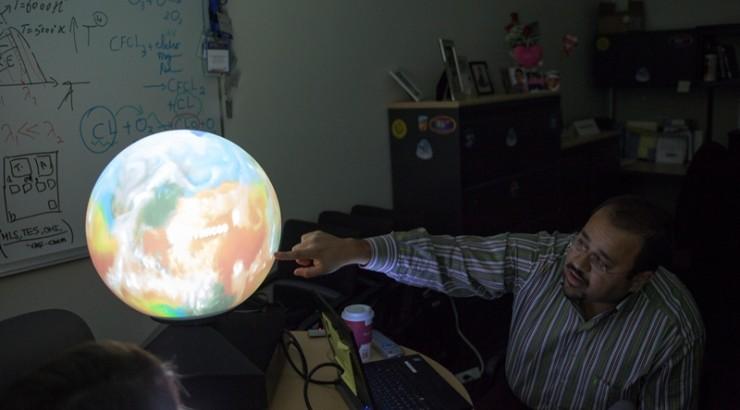 man with rainbow ball