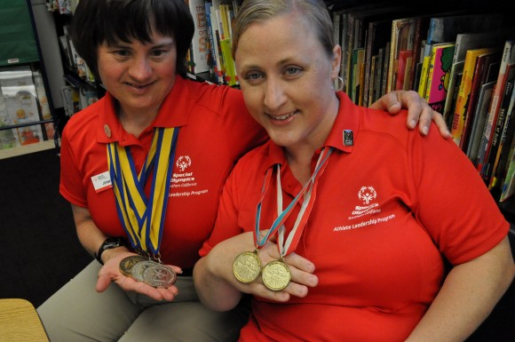 Jenny Skinner, left, and Debi Anderson, display a few of the medals they've won at Special Olympics.