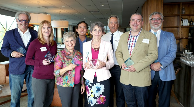 Together at the Faculty Research Recognition Reception are (from left) Mark Axelrod, Julia Boehm, Judy Montgomery (accepting for Kris De Pedro), Miao Zhang, Janeen Hill, Frank Frisch, Justin Walsh and Chancellor Danielle Struppa.