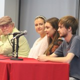 students and man speaking at table