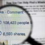 magnifying glass view of facebook post likes and comments