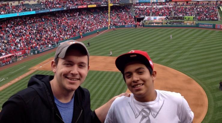 man and boy at baseball game