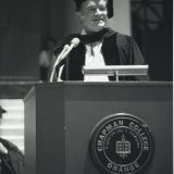 man speaking at podium for commencement