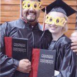 graduates holding programs