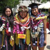 graduates in celebration leis