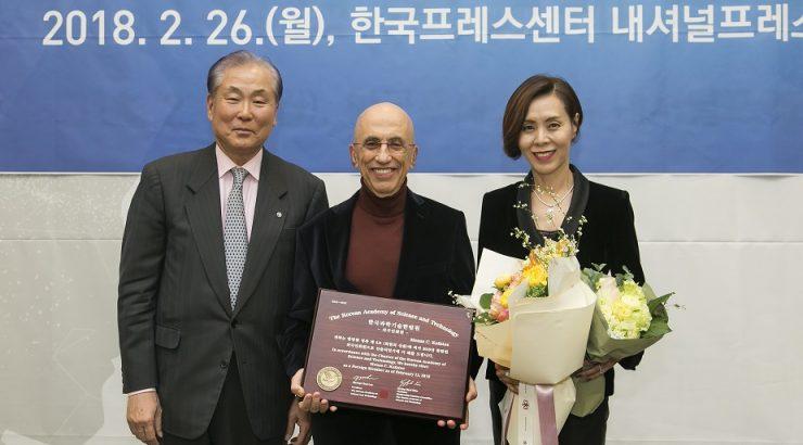 Dr. Kafatos accepts award