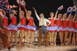 President Jim Doti and students in the 2011 American Celebration stage show at Chapman University.