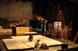 "Stage crews work on the set for the rock musical ""Spring Awakening,"" which will include several classroom chairs assembled into the shape of an abstract tree."