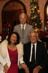 Catherine and James Emmi, pictured here with President Jim Doti at the annual Christmas at the Ritz event