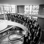 Chapman University Singers standing on the Argyros Forum spiral staircase