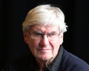 man's face, white hair, wearing eyeglasses