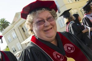 image of woman in commencement gown and cap