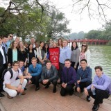 group of students in front of bridge