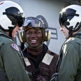 soldier smiling with two pilots