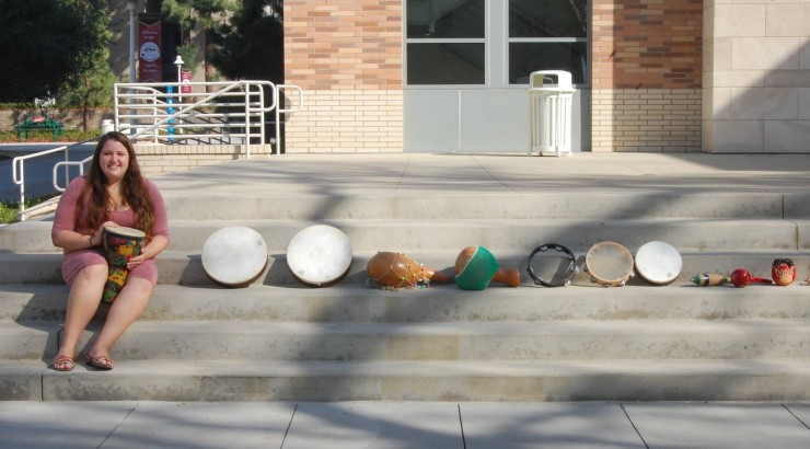 student with many different drums