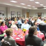 Students, staff, faculty and donors listen to what Eric Brandt has to say.