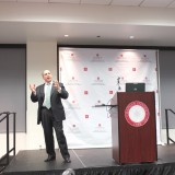 Eric Brandt speaks to the Argyros School community.