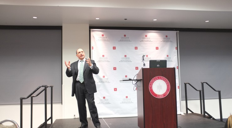 Businessman Eric Brandt speaks to the Argyros School community.