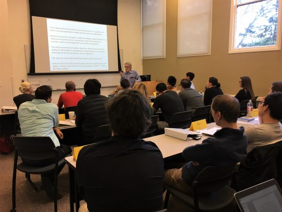 Vernon Smith lecturing to the 2019 Graduate Workshop attendees
