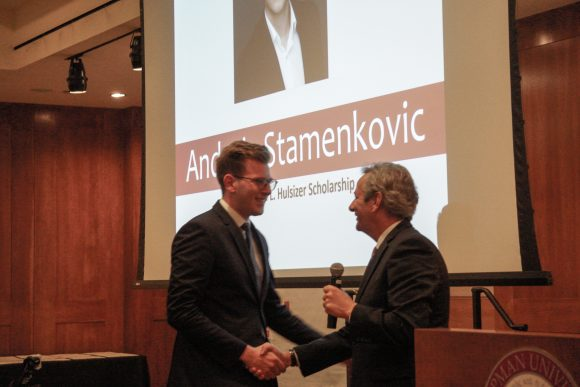 Andreja Stamenkovic and Dean Turk shaking hands
