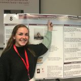 Zina Gorin in front of her research poster