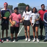 Austin Price on the tennis court with team members
