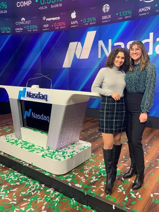 Alisa and a classmate at the Nasdaq desk