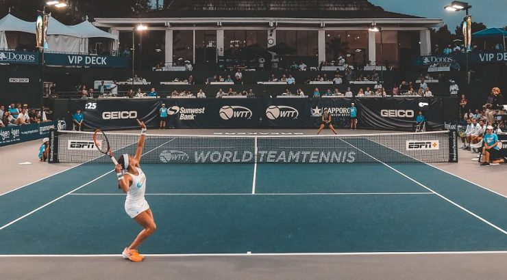 Woman serving in Tennis