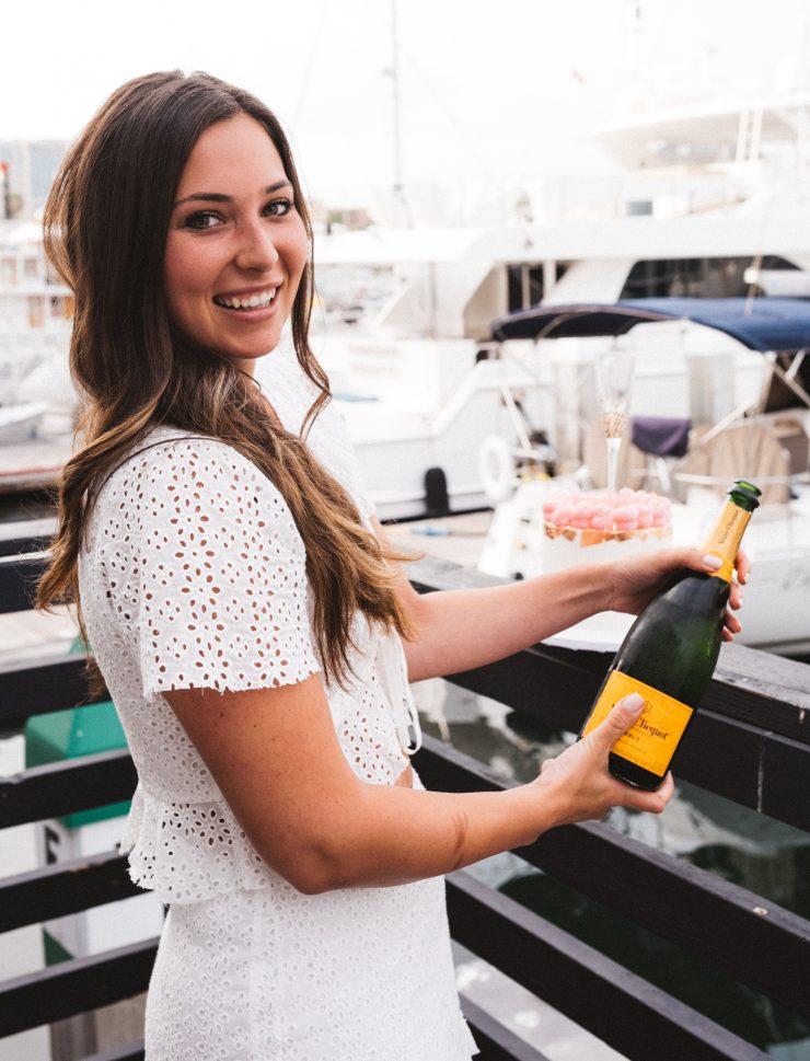 Nicci Julian with champagne bottle