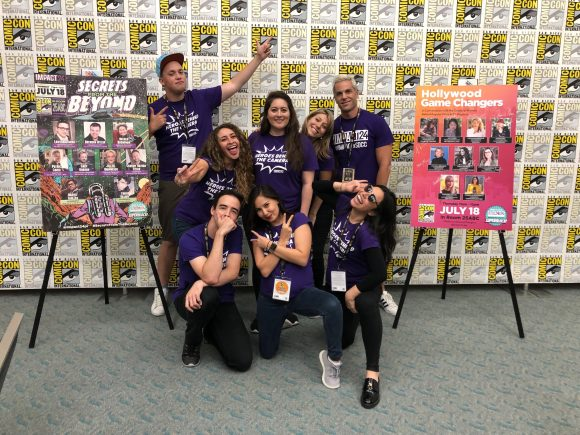 group of smiling young adults at ComicCon