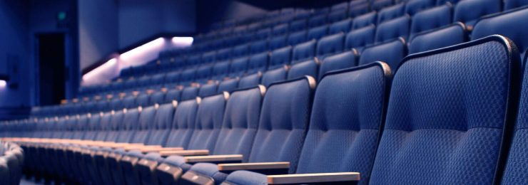 rows of blue seats in Waltmar Theatre