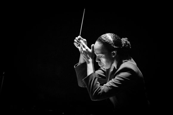 Black-and-white photo of Kalena Bovell conducting
