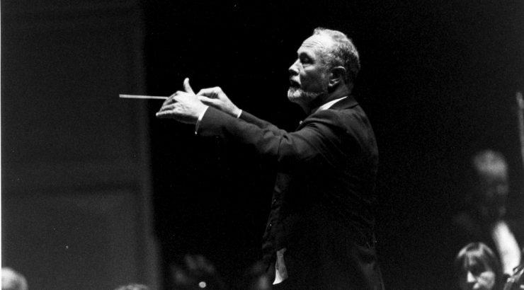 William Hall conducting dressed in a tuxedo.
