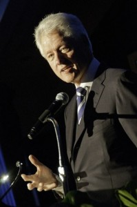 Bill Clinton speaking into microphone.