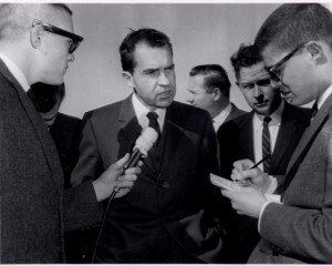 Group of people interviewing Richard Nixon.