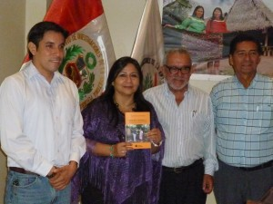 Group of people smiling with book.
