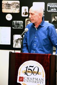 Man at podium speaking.
