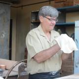 Man making pizza.