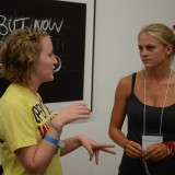 Two women talking.