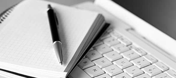 Graph paper, pen, and a laptop.