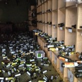 Wine storage covered in bottles from earthquake.