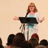 Woman giving speech.