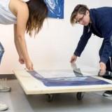 Two women creating art.