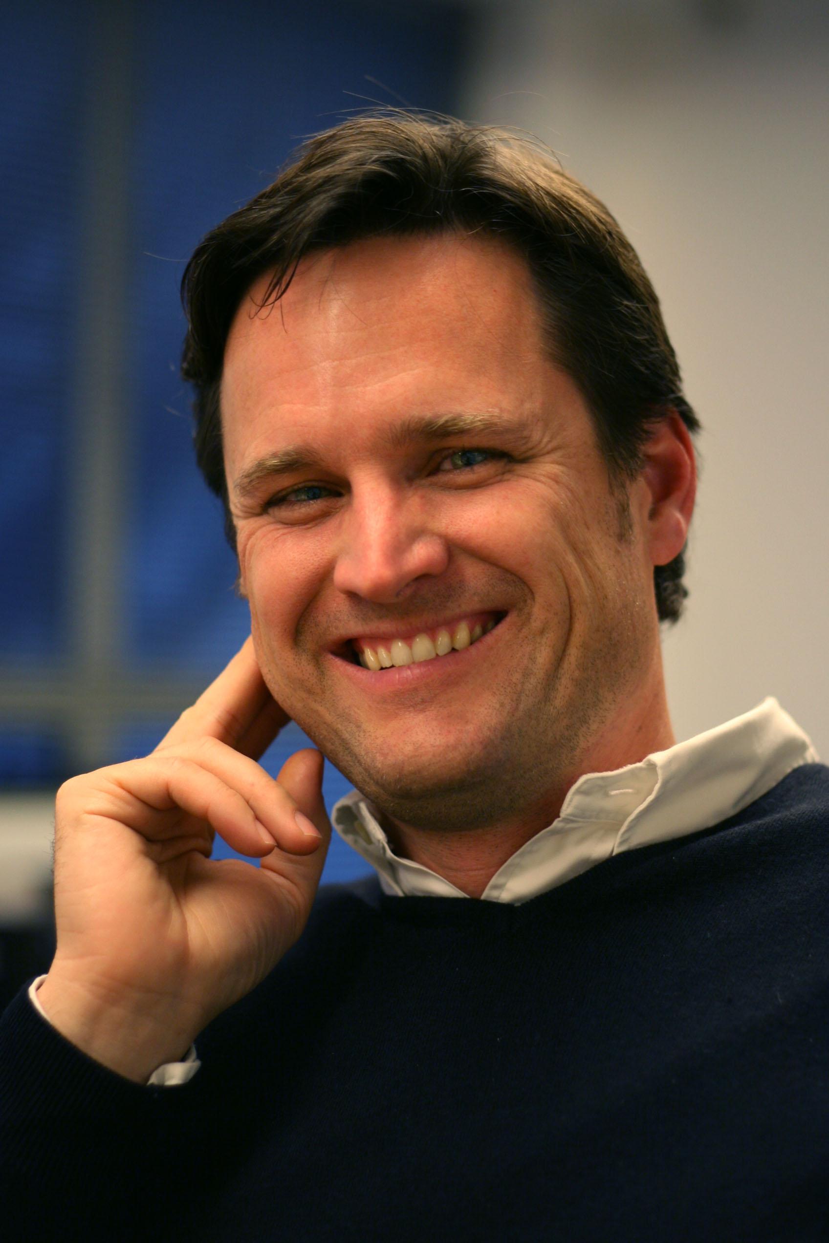 Man smiling.