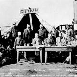 Historical photo of group of men outside City Hall tent