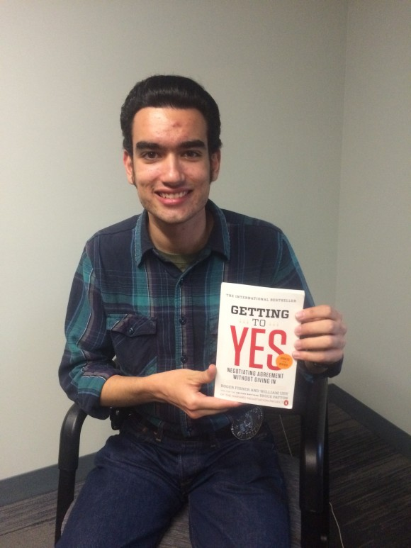Man holding book, Getting to Yes.